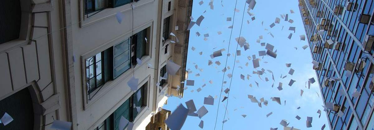 papers falling