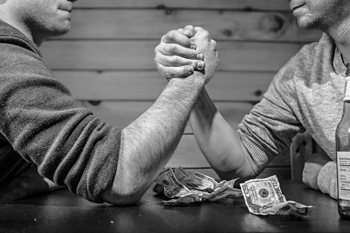 arm wresting at a bar