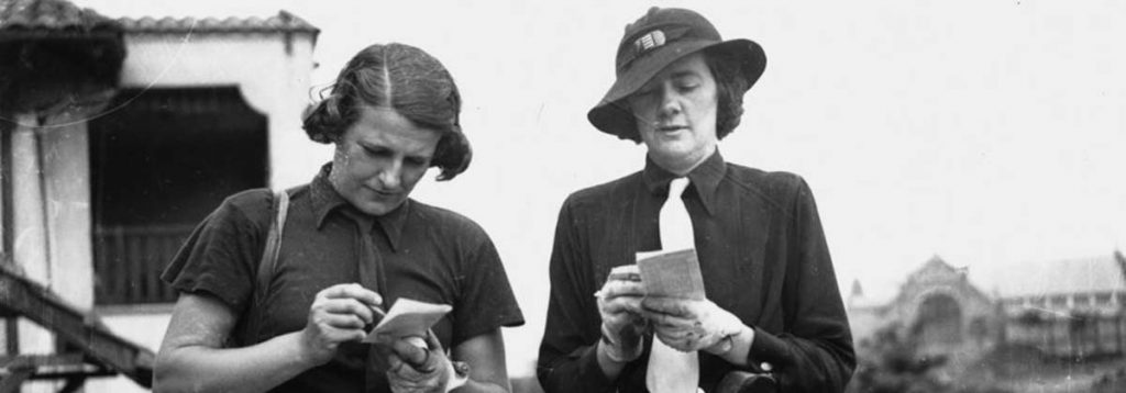 two women taking notes